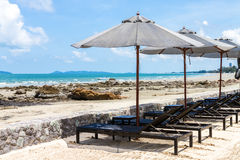 Daybed and umbrella on the beach Royalty Free Stock Photos
