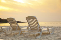 Daybeds on the Beach Stock Photos