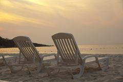 Daybeds on the Beach Royalty Free Stock Photos
