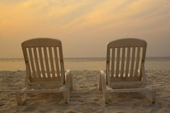 Daybeds on the Beach Royalty Free Stock Images