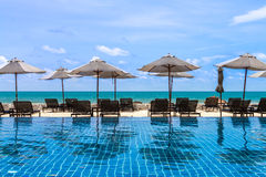 Daybeds at poolside with sea view Stock Photos