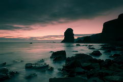 Daybreak. Long exposure photograph of daybreak over a rocky coastline Royalty Free Stock Image