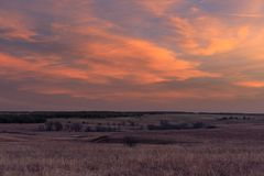 Daybreak. As the sun rises in the distance at the Tallgrass Prairie Preserve in Pawhuska, Oklahoma, February 2018 stock image
