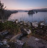 Daybreak on castle ruins. Standing on the battlements of Innis Chonnell castle on Loch Awe Royalty Free Stock Photography
