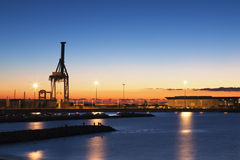 Daybreak at the harbour. Low key shot of a dawn at the port of Alicante Stock Photos