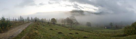 Daybreak in mountain. Misty daybreak in autumn Carpathian mountain, Ukraine. Ten shots stitch image Stock Image