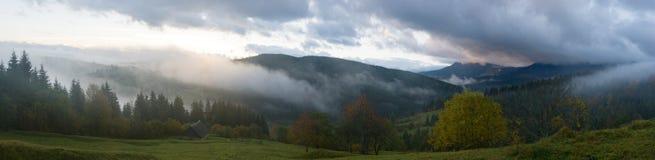 Daybreak in mountain. Misty early daybreak in autumn Carpathian mountain, Ukraine. Ten shots stitch image royalty free stock images
