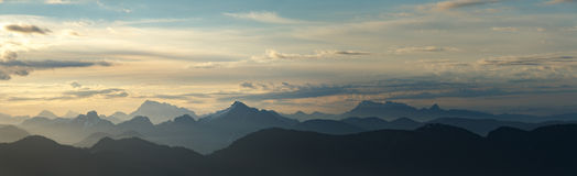 Daybreak Over Mountains Panorama. Daybreak over a vast mountain range. Taken from Mount Seymour in North Vancouver, BC, Canada stock photo