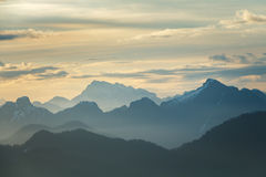 Daybreak Over Mountains. Daybreak over a vast mountain range. Taken from Mount Seymour in North Vancouver, BC, Canada royalty free stock images