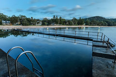 Daybreak Seascape with Seapool. Early morning by the pool at Pearl Beach, Central Coast, NSW, Australia Stock Images