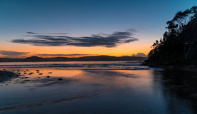 Daybreak Seascape with Silhouettes. A very high tide at Umina Point, Umina, NSW, Australia Royalty Free Stock Image