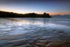 Daybreak at Three Cliffs Bay Stock Photography
