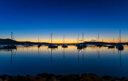 Daybreak waterscape over the bay with boats. Sunrise at Koolewong Foreshore, Koolewong, Central Coast, NSW, Australia Stock Photography