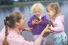A daycare instructor playing with children Royalty Free Stock Image
