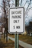 A daycare parking only 5 minute sign.  Stock Photography