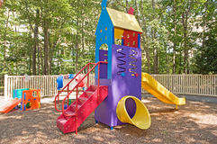 Daycare playground equipment. Outdoor playground equipment at a daycare center including a slide Royalty Free Stock Photography
