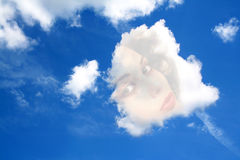 Daydream. Face of a woman in a cloud in the sky, daydream of a lover - thinking of his girl Royalty Free Stock Images