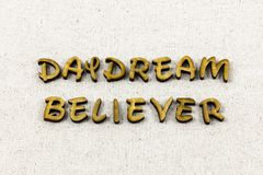Daydream believer believe dream dreamer letterpress type. Daydream believer believe dream dreamer typography letter dreaming enjoy success plan achieve positive royalty free stock photo