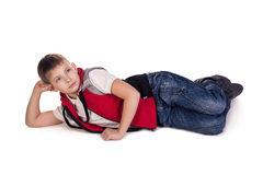 Daydream. Small boy laying. Daydream.  on white Stock Image