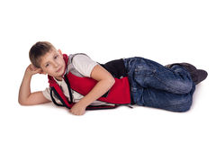 Daydream. Small boy laying. Daydream.  on white Royalty Free Stock Photo