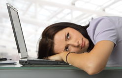 Daydreaming. Portrait of a girl resting with his head on a laptop Stock Photography