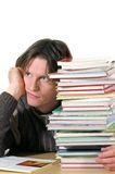 Daydreaming. Depressed student/teacher with pile of books Stock Photography