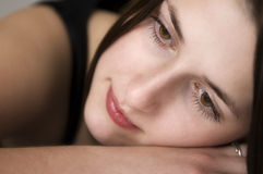 Daydreaming. Pretty girl dreaming, laying her head on her hand Royalty Free Stock Images