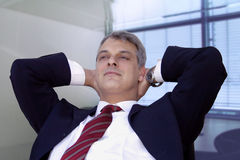 Daydreaming. Businessman relaxing in his office Royalty Free Stock Photography