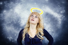 Daydreaming angel Stock Images