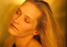 Daydreaming blond beauty stock photo
