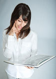 Daydreaming with book Stock Photo