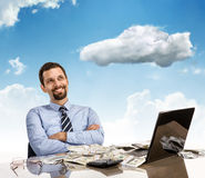 Daydreaming businessman with arms crossed Stock Images