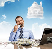 Daydreaming businessman with a cup of tea with head in the clouds Royalty Free Stock Photography