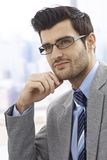 Daydreaming businessman Stock Images