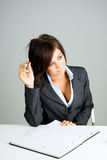 Daydreaming businesswoman Royalty Free Stock Photos