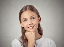 Daydreaming child, smiling girl royalty free stock images