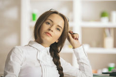 Daydreaming female at workplace Royalty Free Stock Images