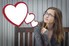 Daydreaming Girl With Blank Floating Hearts - Clipping Path Royalty Free Stock Images