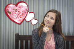 Daydreaming Girl Next To Floating Hearts with Pink Roses Royalty Free Stock Photos