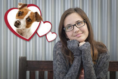 Daydreaming Girl Next To Floating Hearts with Puppy Within Stock Photography