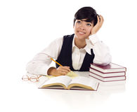 Daydreaming Mixed Race Female Student with Books Royalty Free Stock Photos