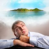 Daydreaming office worker. Tired office worker daydreaming about tropical vacation Royalty Free Stock Photos