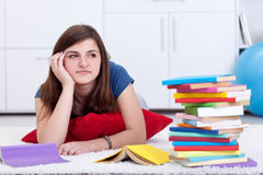 Daydreaming by the school books Stock Images