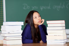 Daydreaming schoolgirl Royalty Free Stock Images