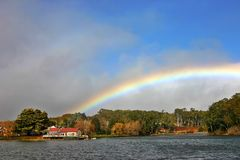Daylesford Boat House no. 2. Daylesford Boat House with a rainbow in the sky. Located in Victoria Australia Stock Images