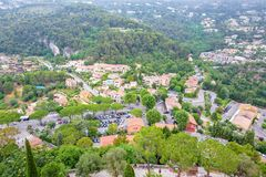 Daylight foggy view to Eze, Cote d`Azur village with medieval ho. Daylight foggy view to Eze, France Cote d`Azur village with medieval houses, roads and green stock image