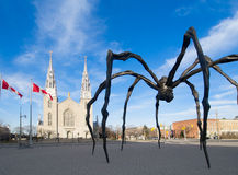 Daylight Giant Spider and Church Stock Images