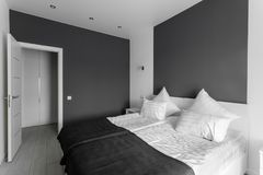 Daylight morning. Hotel standart room. modern bedroom with white pillows. simple and stylish interior. stock photos