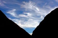 Daylight-1. Photo of sky framed using rock formation Stock Photo