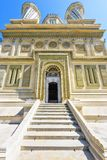 Daylight portrait view to monastery entrance, facade and domes. Daylight portrait view to monastery entrance, stairs, ornamented facade and domes. Religious Royalty Free Stock Images